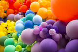 Bright abstract background of jumble of rainbow colored balloons celebrating gay pride - 208972901
