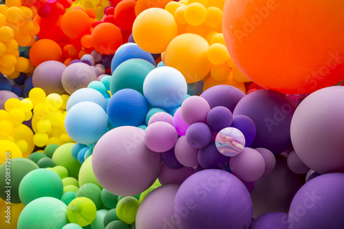 Foto Murales Bright abstract background of jumble of rainbow colored balloons celebrating gay pride