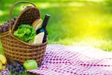 Picnic basket in summer park - 208973182
