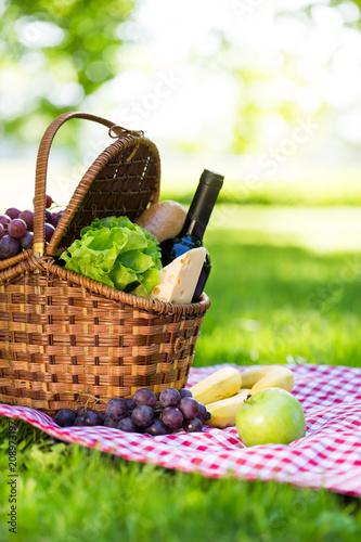 Fototapeta Picnic basket in summer park