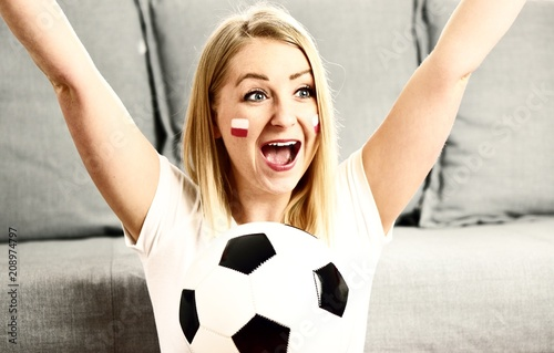 Polish fan cheers football team in the national colors. - 208974797
