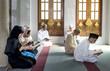 Leinwanddruck Bild - Muslims reading from the quran