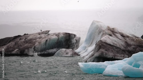 Birds battling extreme winds in slow motion over the Jökulsárlón Glacier Lagoon in Iceland