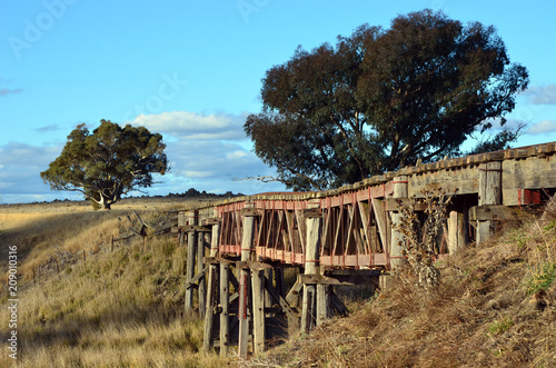 Fotobehang Bruggen Old abandoned wooden railway bridge over the Boorowa River, in rural central west NSW, Australia