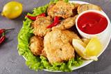 close-up of pan fried pieces of hake - 209018396