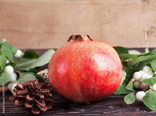 Fresh pomegranate on wood