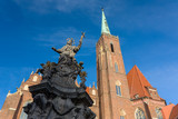 Statue of St. John of Nepomuk, 18th century monument and Cathedral of St John the Baptist at background, Wroclaw, Poland.