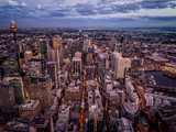 Tall buildings in the city and in the evening from above - 209037397
