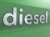 diesel writing on car paint surface to illlustrate diesel scandal call-backs green paint