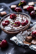Leinwanddruck Bild - Fresh cherries in bowl with chocolate on dark tablecloth