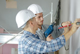 professional workmen working on a wall - 209051787