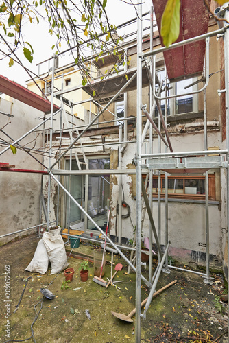 Scaffolding on terrace against dirty and grunge wall and window