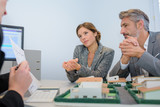 Executives discussing property development - 209053177