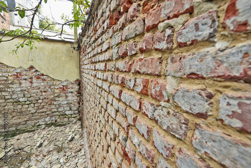 Dirty and grunge red brick wall from exterior