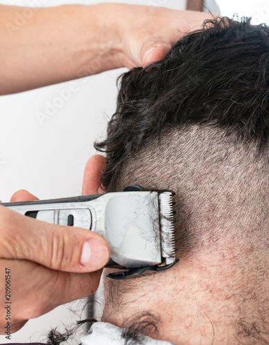 men's haircut with a typewriter
