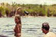 Couple enjoying bathing in lake