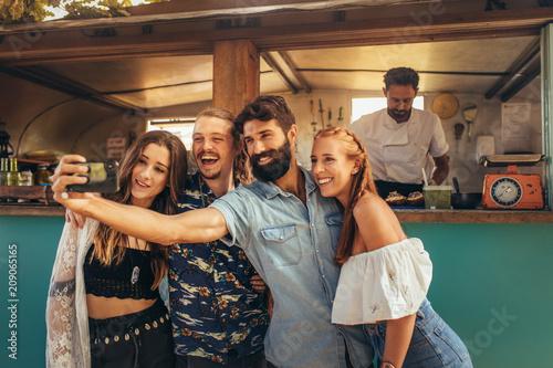 Leinwanddruck Bild Millennial friends group taking selfie.