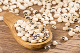 Black eye bean - Vigna unguiculata. Wooden spoon - 209071955