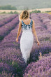 Woman walking at lavender field