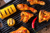 Rustic Grilled chicken wings,legs,and spicy corn - 209073340