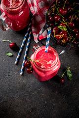 Summer fruity vitamin drink. homemade cherry smoothie on dark background