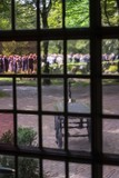 Funeral as seen through stained window