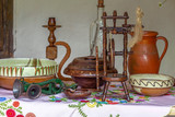 Traditional Hungarian objects exhibited on one home porch - 209086395
