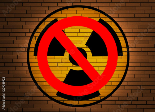 Sticker Stop nuclear -  radiation sign on a brick wall.