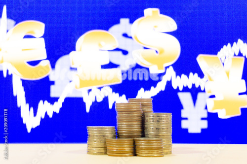 Leinwandbild Motiv Stack of money with blur graph currency on background , finance concept,saving money concept,save money.