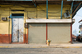 street corner with store on ground floor / shop with closed shutter  - 209098372