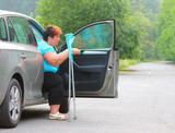 Disabled woman upgoing from a car. Transportation and travel for handicapped people. - 209104572