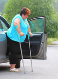 Disabled woman upgoing from a car. Transportation and travel for handicapped people. - 209104592