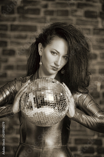 girl in a tight suit with a disco ball, sepia - 209106579