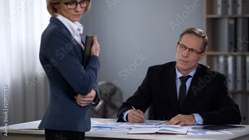 Leinwanddruck Bild General director with frank male interest looking at secretary, offensive abuse