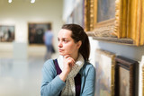 Portrait of woman who is visiting art gallery - 209115153