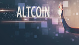 Altcoin with a hand in a dark light background - 209116730