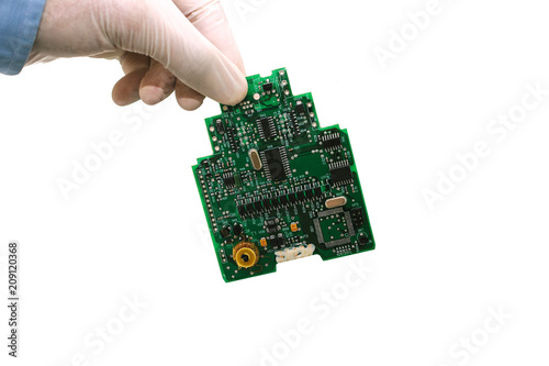 A man takes a hand or holds a computer board on a white background