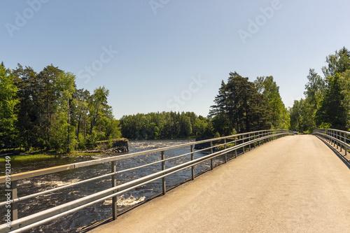 Fotobehang Beige Bridge and a river