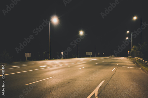 Fotobehang Nacht snelweg night empty highway under lanterns light concept