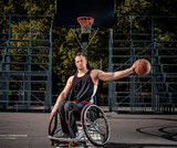 Portrait of a disabled basketball player in a wheelchair on an open gaming ground. - 209127196