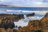 The picturesque rock at the coast of the Atlantic Ocean is washed by waves - 209128589