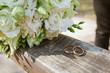 Leinwanddruck Bild - Wedding bouquet with rings on a tree