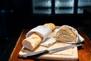 French baguette and bread on wooden board