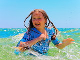 A teenage girl loves to swim in the sea.