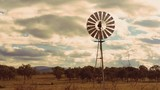 Cinemagraph of a windmill in the countryside of Queensland, Australia. - 209176107