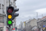 Green and yellow light semaphore on city urban with blury background - 209177981