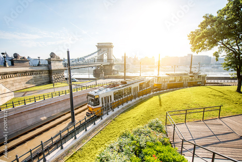 Fotobehang Bruggen Cityscape view on the tram and famous Chain bridge on the background during the morning light in Budapest city, Hungary