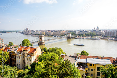 Panoramic view on Budapest city with Chain bridge and famous Parliament building during the morning light in Hungary © rh2010