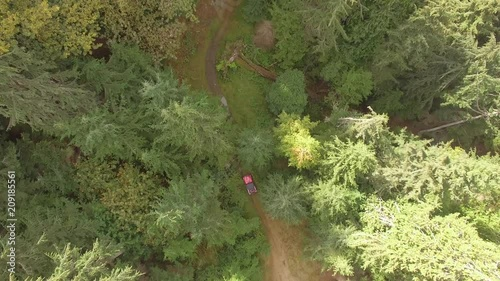 Aerial Pursuit Of A Car Riding Along The Dirt Road In The Middle Of Nowhere