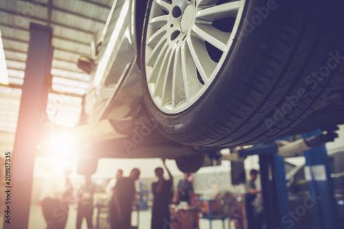 Mechanic repairing a car - 209187335